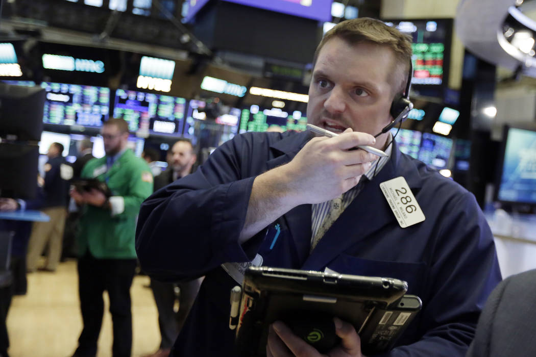 Trader Michael Milano works on the floor of the New York Stock Exchange, Friday, Feb. 9, 2018. U.S. stocks wavered between small gains and losses in morning trading Friday, giving up some of a big ...