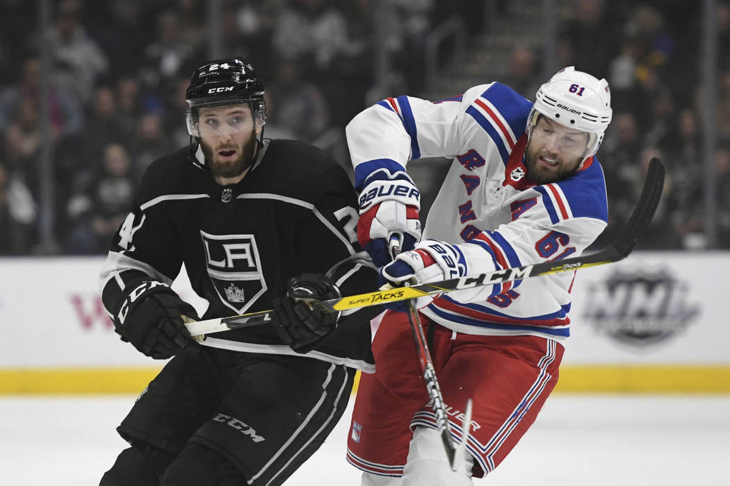 Los Angeles Kings defenseman Derek Forbort, left, and New York Rangers left wing Rick Nash battle for position during an NHL hockey game, Sunday, Jan. 21, 2018, in Los Angeles. (AP Photo/Michael O ...
