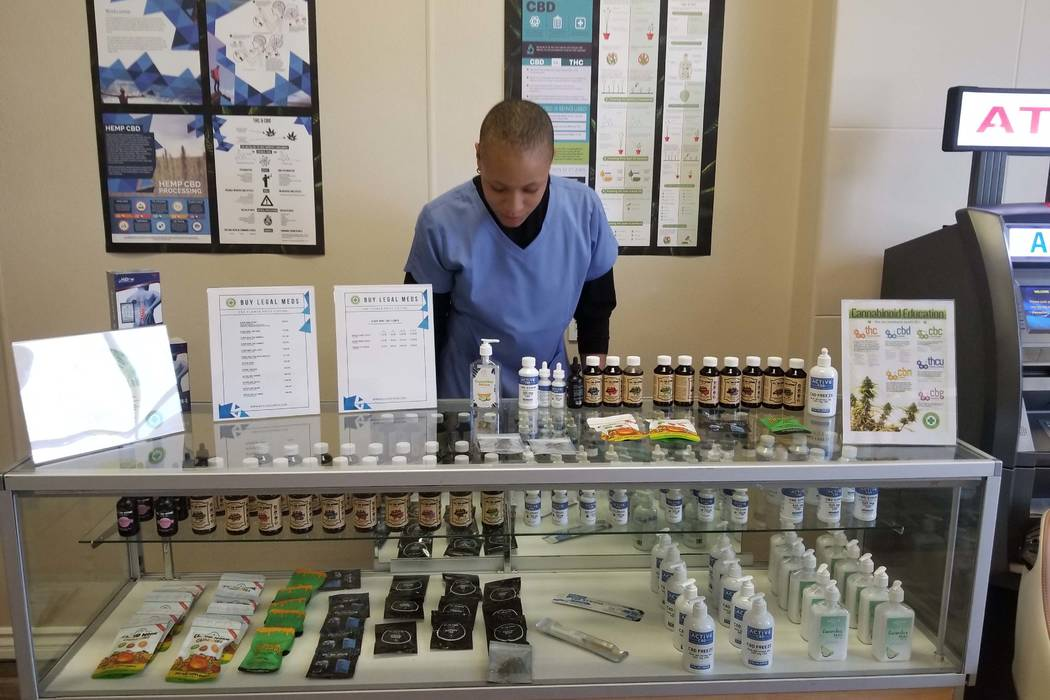 Breona Vaughn works the counter at Buy Legal Meds on Wednesday, Jan. 31, 2018. The online retailer of products made with cannabis oil opened a brick-and-mortar store earlier this year. (Wade Millw ...