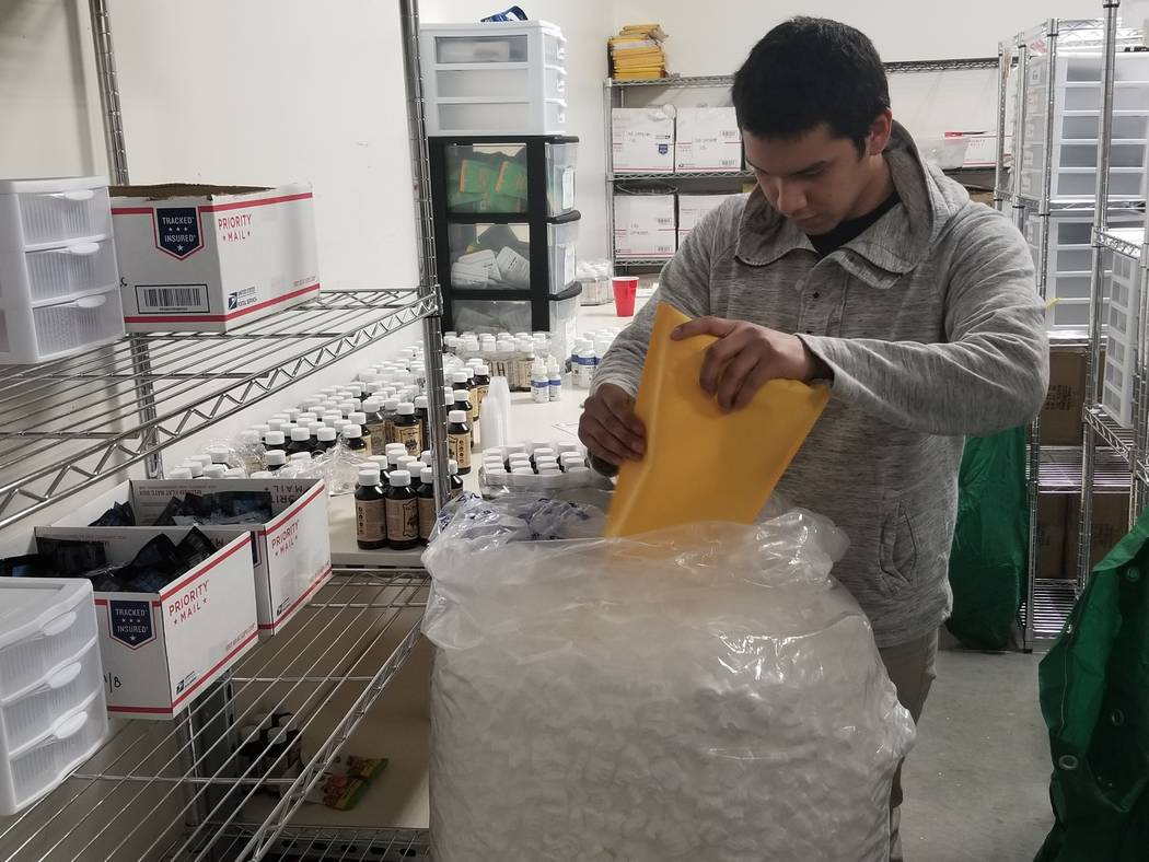 Moisy Reyes packages products at Buy Legal Meds' 5,000-square-foot manufacturing site on Tuesday, Feb. 6, 2018. The online retailer opened its first brick-and-mortar store earlier this year. (Wade ...