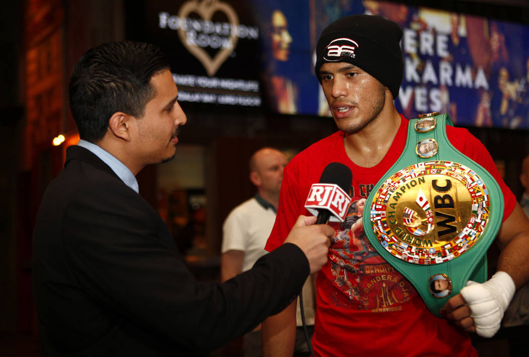 WBC super middleweight champion David Benavidez, right, is interviewed by Gilbert Manzano of the Las Vegas Review-Journal during the open workouts at the Mandalay Bay in Las Vegas, Wednesday, Feb. ...