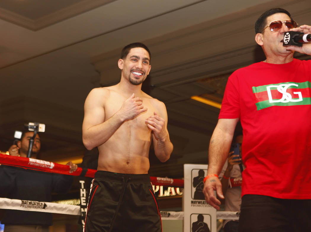 Welterweight boxer Danny Garcia, left, smiles as his father Angel Garcia addresses the fans during the open workouts at the Mandalay Bay in Las Vegas, Wednesday, Feb. 14, 2018. Heidi Fang Las Vega ...