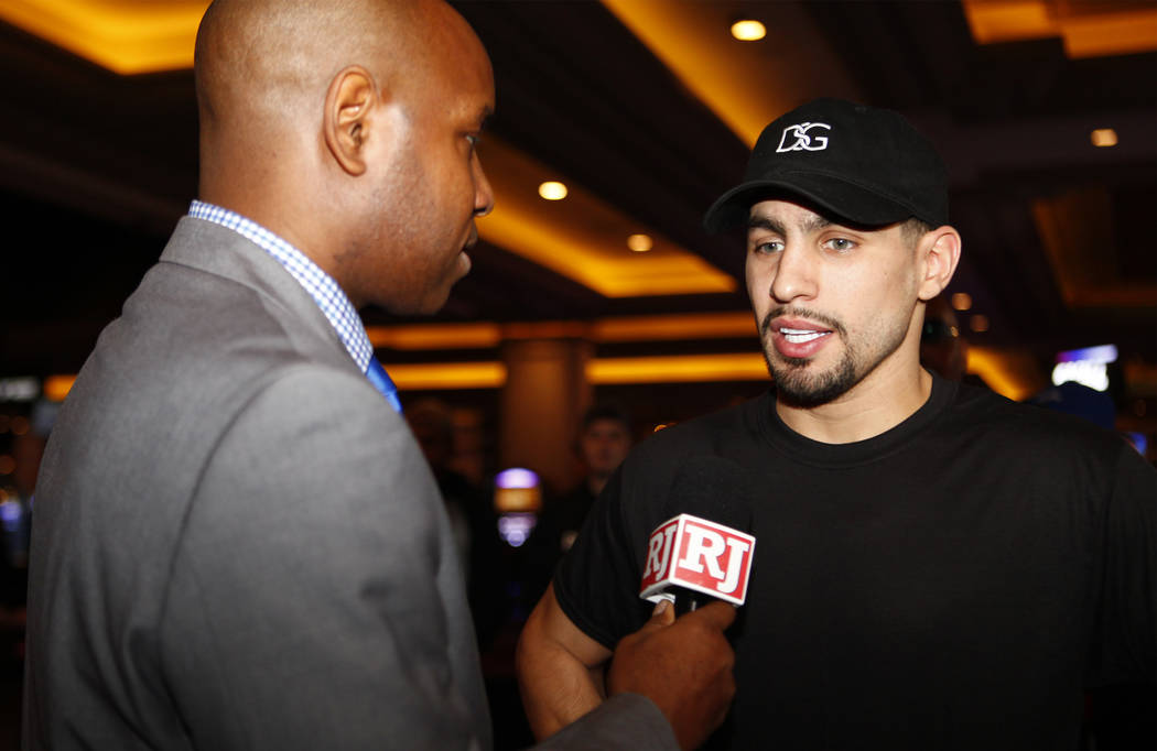 Welterweight boxer Danny Garcia, right, is interviewed by the Review-Journal's Bryan Salmond during the open workouts at the Mandalay Bay in Las Vegas, Wednesday, Feb. 14, 2018. Heidi Fang Las Veg ...