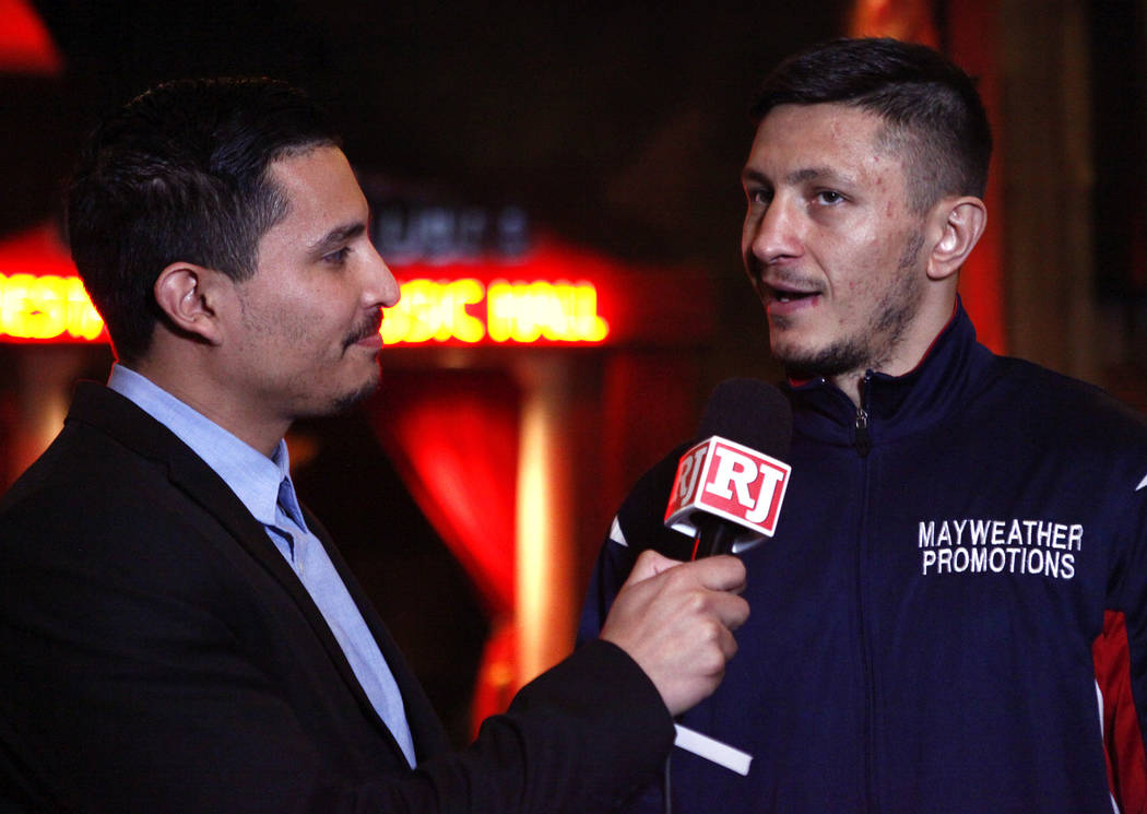 Super middleweight title contender Ronald Gavril, right, is interviewed by the Review-Journal's Gilbert Manzano during the open workouts at the Mandalay Bay in Las Vegas, Wednesday, Feb. 14, 2018. ...
