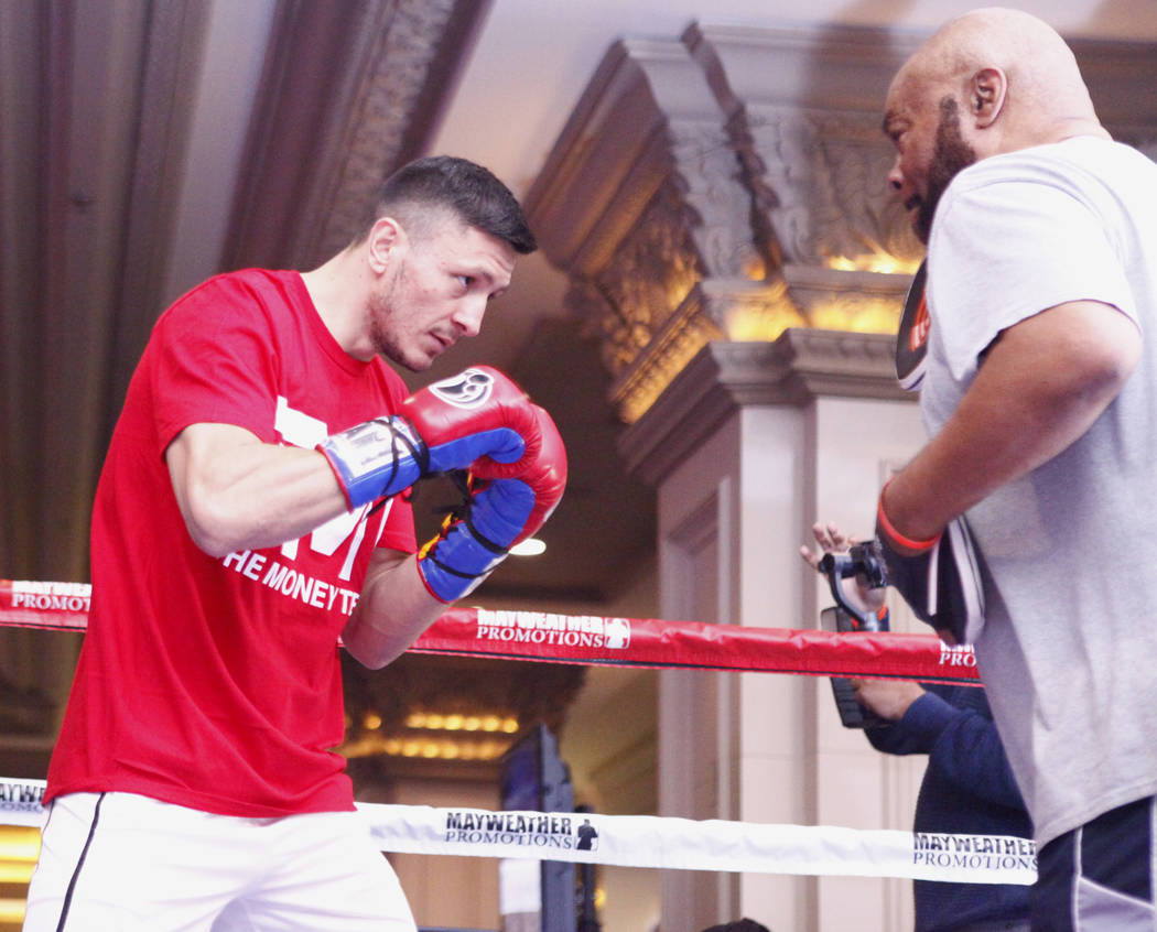 Super middleweight title contender Ronald Gavril, left, hits mitts with his trainer Eddie Mustafa at the open workouts at the Mandalay Bay in Las Vegas, Wednesday, Feb. 14, 2018. Heidi Fang Las Ve ...