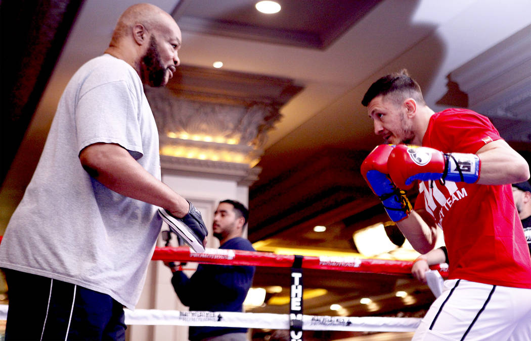 Super middleweight title contender Ronald Gavril, right, hits mitts with his trainer Eddie Mustafa at the open workouts at the Mandalay Bay in Las Vegas, Wednesday, Feb. 14, 2018. Heidi Fang Las V ...