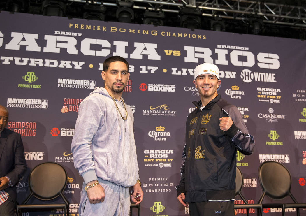 Boxers Danny Garcia, left, and Brandon Rios face off during a press conference at the Mandalay Bay in Las Vegas on Thursday, Feb. 15, 2018.  Garcia and Rios will meet for a 12-round welterweight f ...