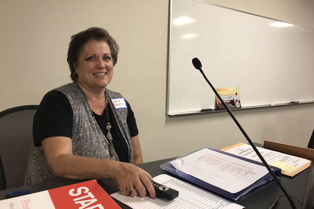 Short-term rental certification instructor Julie Davies sits at the lectern in a classroom at the College of Southern Nevada West Charleston campus on Feb. 9, 2018. (Madelyn Reese/ Las Vegas Revie ...