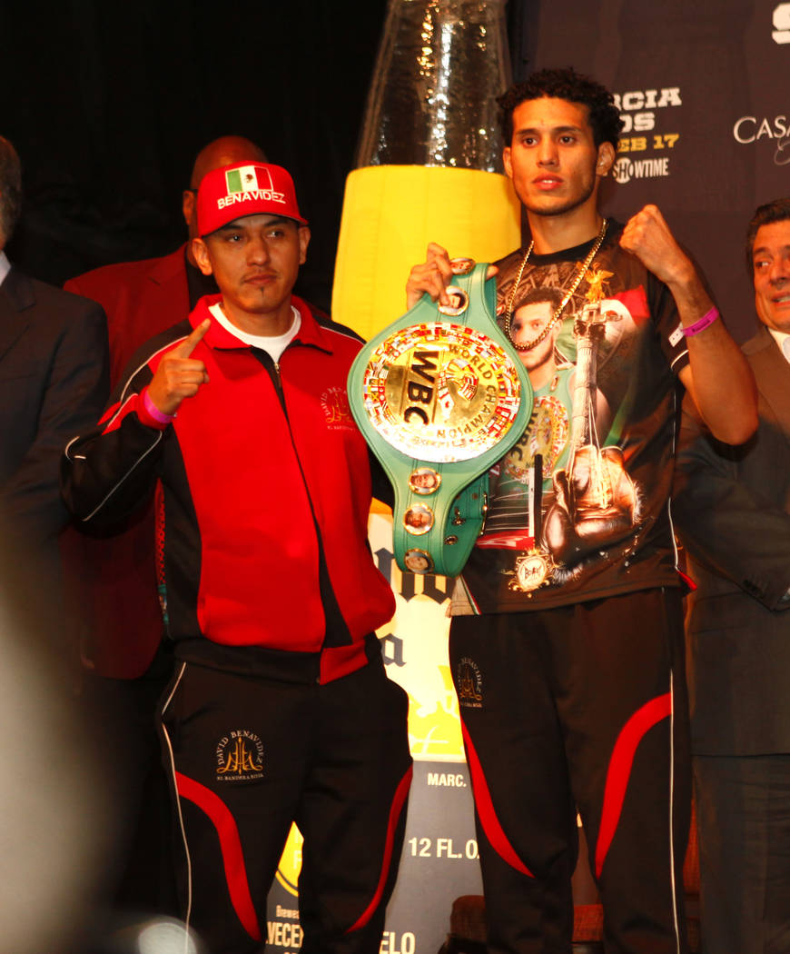 WBC super middleweight champion David Benavidez, right, arrives at the official weigh-in with his father and trainer, Jose Benavidez, Sr., at the Mandalay Bay in Las Vegas, Friday, Feb. 16, 2018.  ...