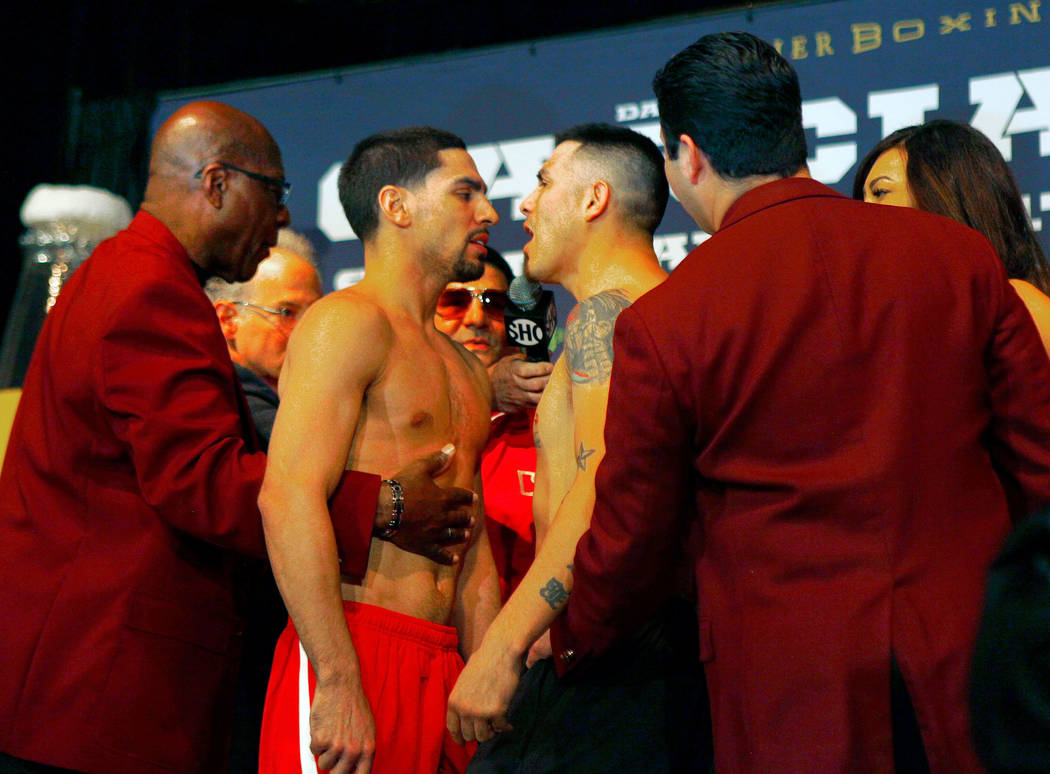 Danny Garcia, left, is held back as Brandon Rios gets up close at the official weigh-in at the Mandalay Bay in Las Vegas, Friday, Feb. 16, 2018. Garcia and Rios will headline the boxing card at th ...