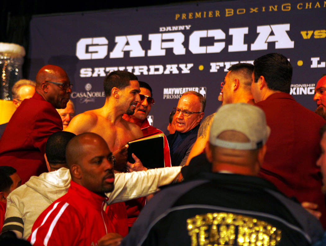 Danny Garcia, left, is held back during a skirmish with Brandon Rios at the official weigh-in at the Mandalay Bay in Las Vegas, Friday, Feb. 16, 2018. Garcia and Rios will headline the boxing card ...