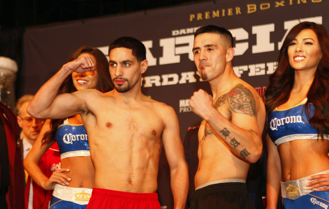 Welterweight boxing headliners Danny Garcia, left, and Brandon Rios, during the official weigh-in at the Mandalay Bay in Las Vegas, Friday, Feb. 16, 2018 ahead of their Feb. 17 bout set for the Ma ...