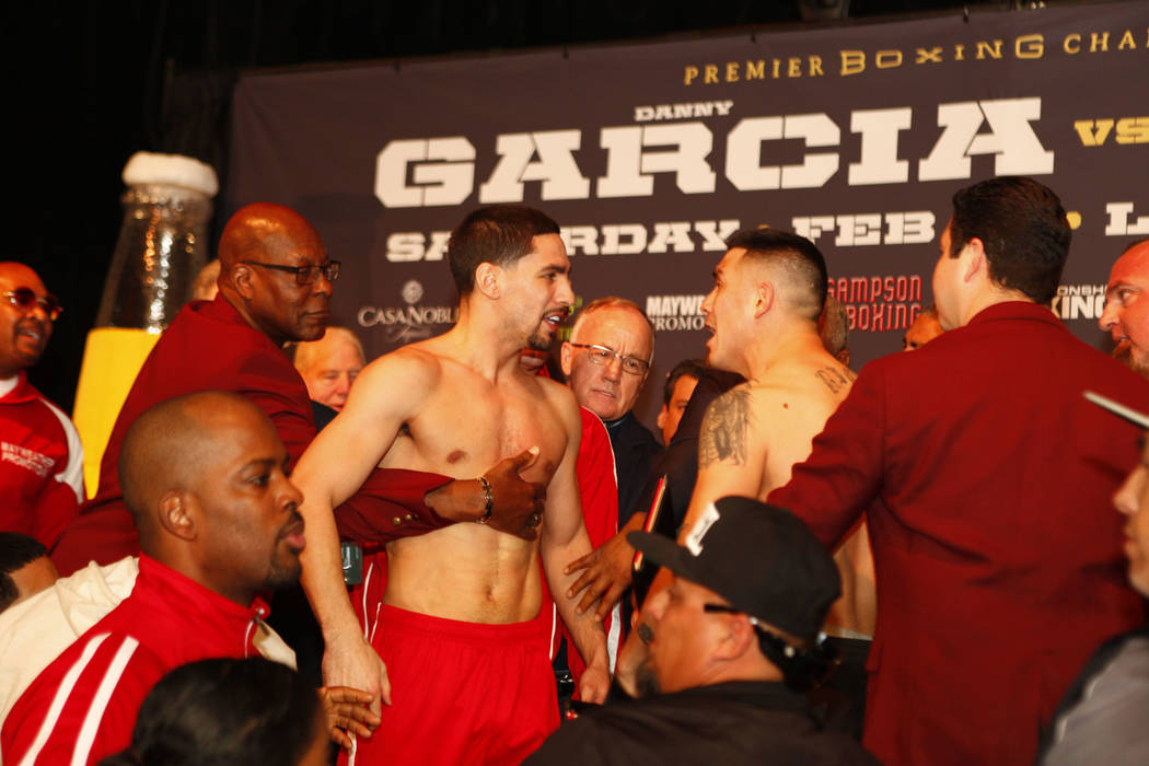 Danny Garcia, left, is held back as Brandon Rios yells at the official weigh-in at the Mandalay Bay in Las Vegas, Friday, Feb. 16, 2018. Garcia and Rios will headline the boxing card at the Mandal ...
