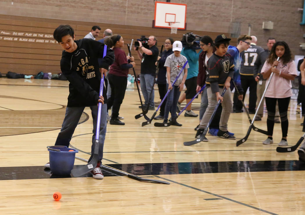 Kai High shoots to the goal at Walter Johnson Junior High School on Monday, Feb. 12, 2018, in Las Vegas. Vegas Golden Knights and Clark County School District will bring street hockey to Clark Cou ...