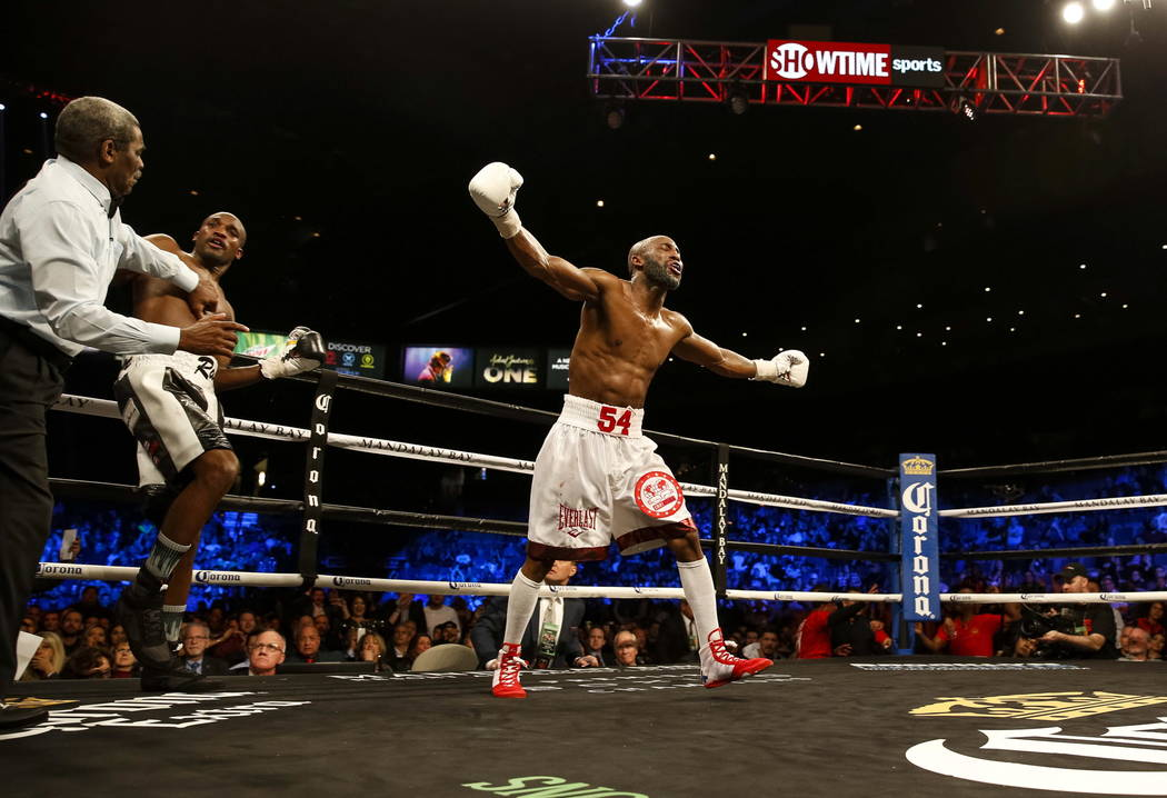 Yordenis Ugas of Cuba celebrates his seventh round TKO victory over Ray Robinson of Pennsylvania after referee Robert Byrd called the fight in a welterweight boxing match at the Mandalay Bay Event ...