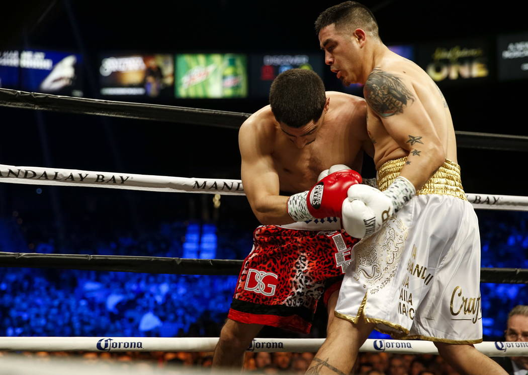Danny Garcia of Pennsylvania, left, and Brandon Rios of California fight during a welterweight boxing match at the Mandalay Bay Events Center in Las Vegas on Saturday, Feb. 17. Richard Brian Las V ...