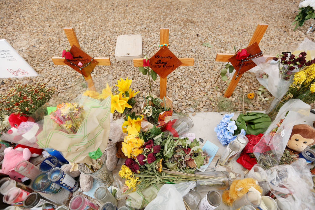 Three crosses with the names of three juveniles between the ages of 12 and 15 that were hit by a car on Desert Inn Road and east of Nellis Boulevard, at a memorial site  Wednesday, Oct. 18, 2017 i ...