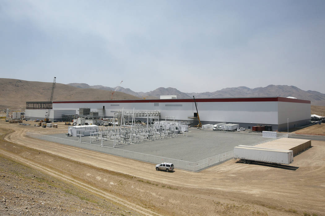 An overall view of the new Tesla Gigafactory is seen during a media tour Tuesday, July 26, 2016, in Sparks, Nev.  (AP Photo/Rich Pedroncelli)