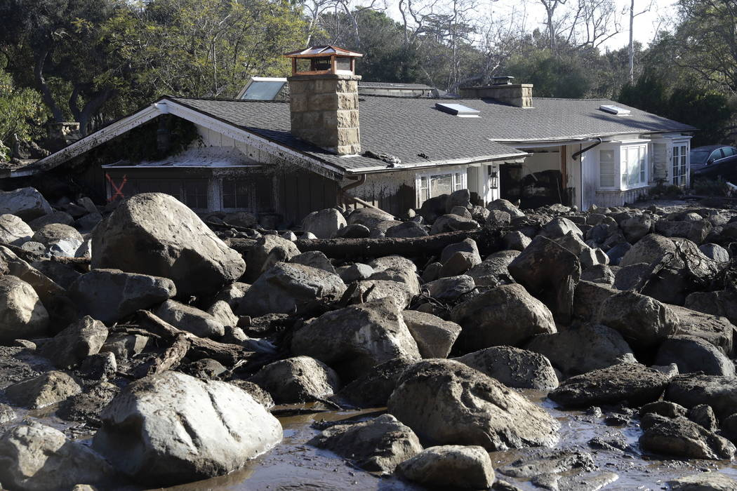 Large rocks and mud are shown in front of a house in Montecito, Calif., last month. (AP Photo/Marcio Jose Sanchez, File)