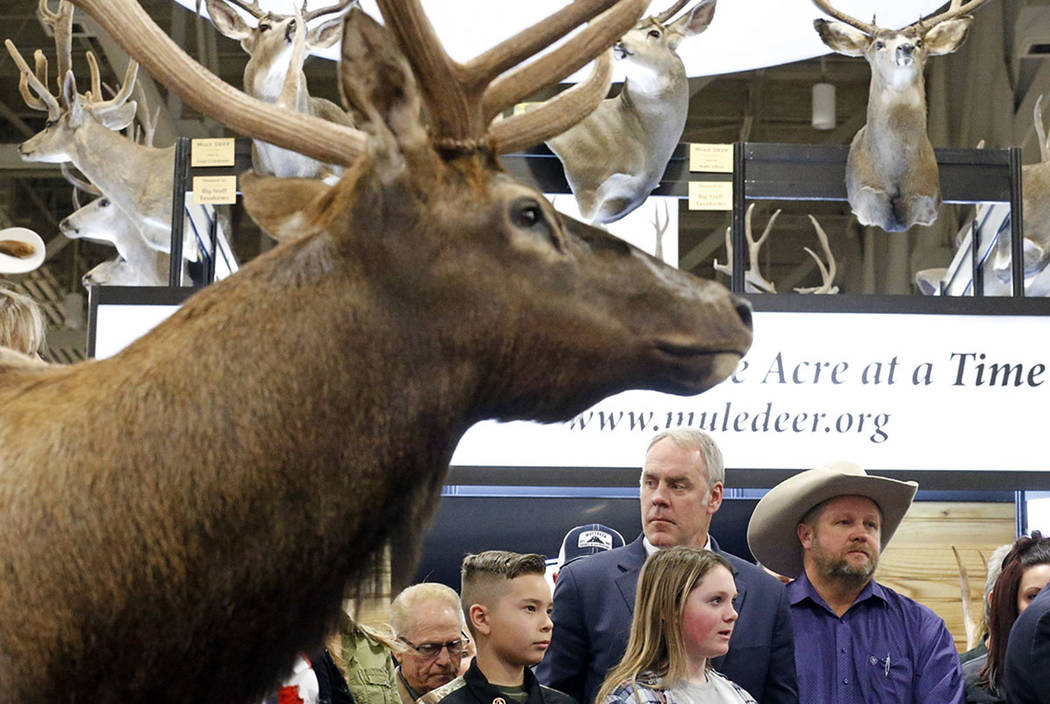 U.S. Interior Secretary Ryan Zinke looks on before speaking at the Western Conservation and Hunting Expo Friday, Feb. 9, 2018, in Salt Lake City. (AP Photo/Rick Bowmer)