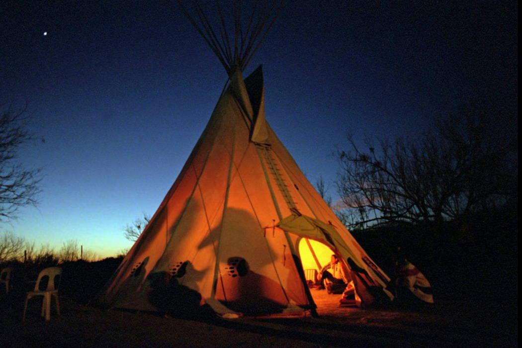 Members of the Native American Church prepare for a prayer meeting in Mirando City, Texas, in 1996.  (Joyce Marshall/Star-Telegram via AP, File)
