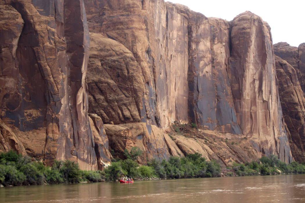 Rafters float down the Colorado River near Moab, Utah, in 2017. (AP photo/Dan Elliott, file).