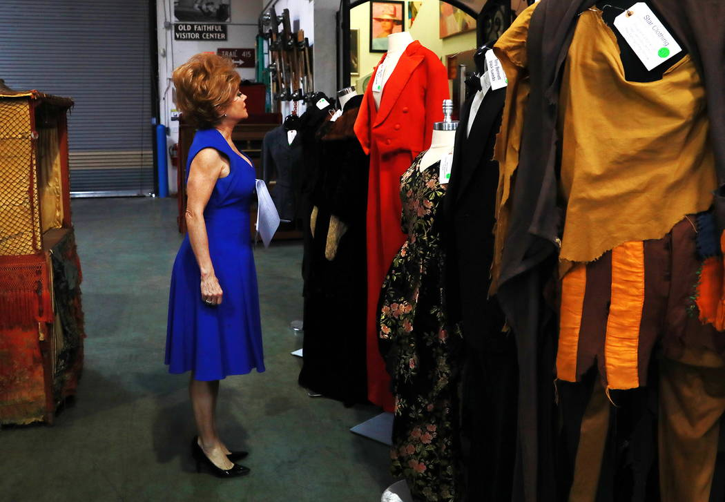 Kathryn Arianoff, who performs in a Debbie Reynolds tribute show, scans through an auction sale, which included almost 800 items collected by Debbie Reynolds and Carrie Fisher, at McManus Auctions ...