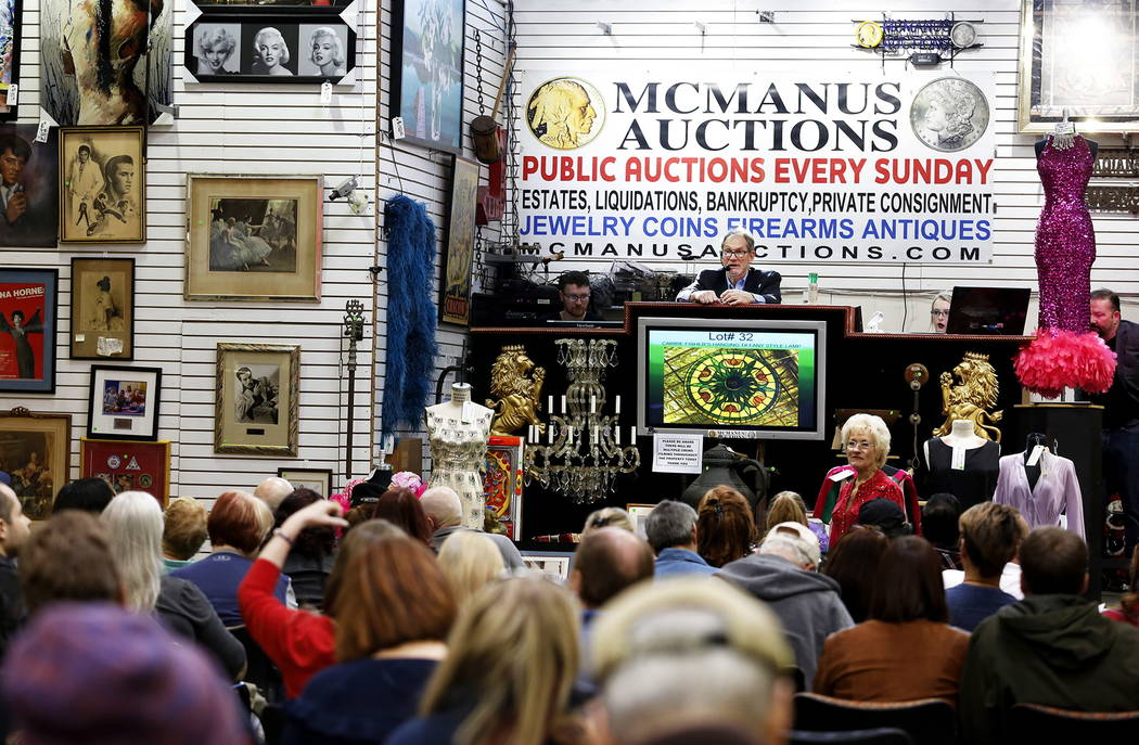 Auctioneer Tom Burbey starts off the bids in an auction sale, which included almost 800 items collected by Debbie Reynolds and Carrie Fisher, at McManus Auctions in Las Vegas on Sunday, Feb. 11, 2 ...