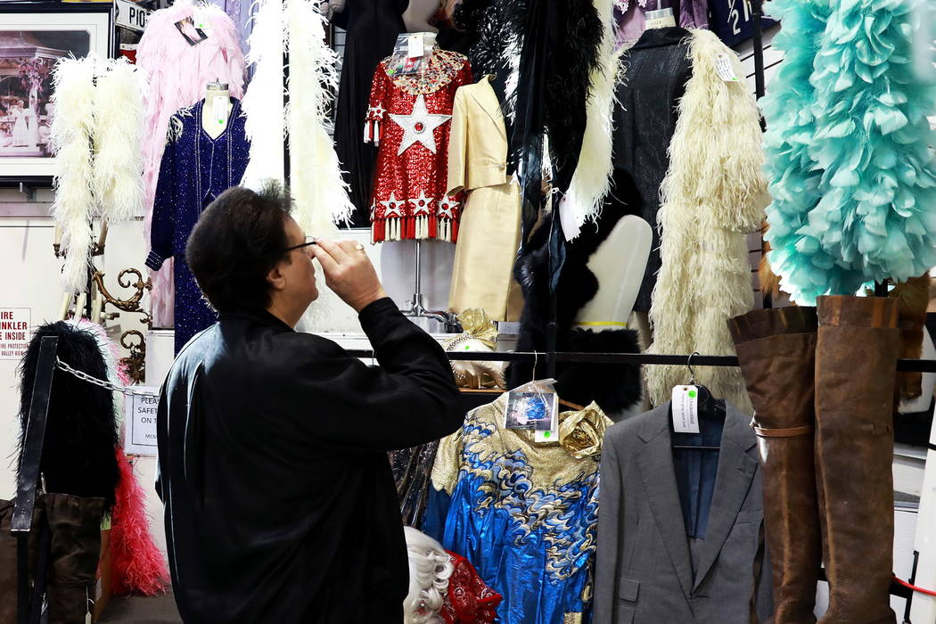 Charlie, who wished to only be identified by his first name, looks at costumes in an auction sale, which included almost 800 items collected by Debbie Reynolds and Carrie Fisher, at McManus Auctio ...