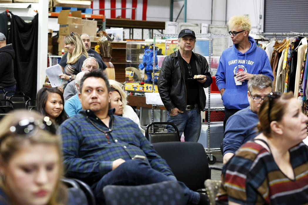 Todd Fisher, center, who presided over the estate sale that included almost 800 items collected by Debbie Reynolds and Carrie Fisher, talks to Murray Sawchuk, right, during the auction at McManus  ...