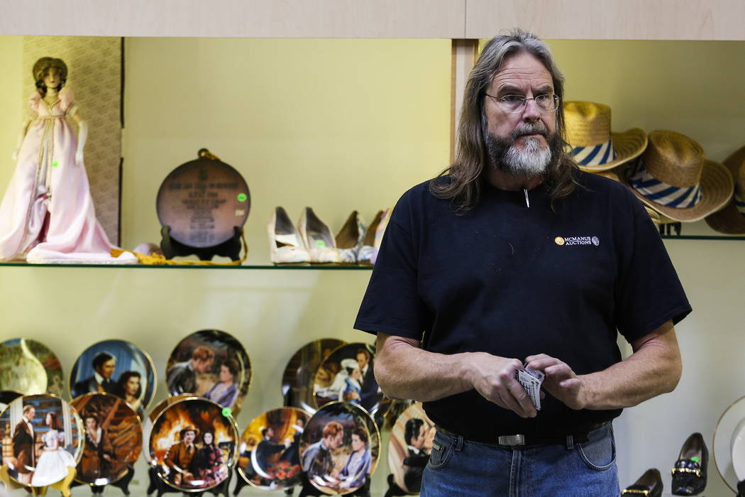 Jeff Bingham works behind the counter during an auction sale, which included almost 800 items collected by Debbie Reynolds and Carrie Fisher, at McManus Auctions in Las Vegas on Sunday, Feb. 11, 2 ...