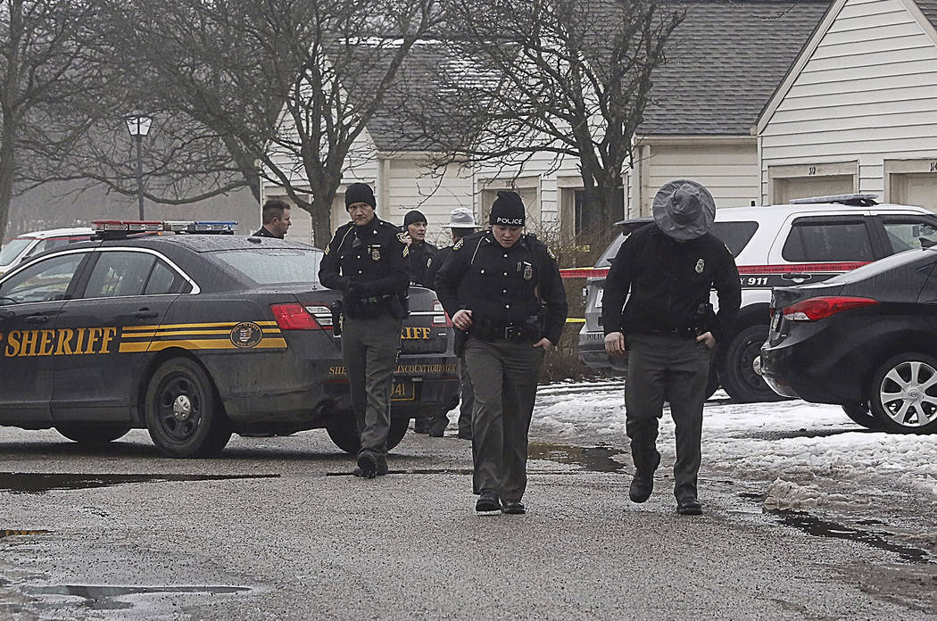 Police investigate the scene of a shooting in Westerville, Ohio, on Saturday, Feb. 10, 2018.  Westerville police have confirmed that two officers have been fatally shot at a home in the Columbus s ...