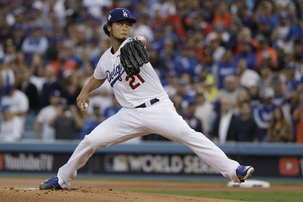 Los Angeles Dodgers starting pitcher Yu Darvish throws during the first inning of Game 7 of baseball's World Series against the Houston Astros, in Los Angeles, Nov. 1, 2017. (AP Photo/Matt Slocum, ...
