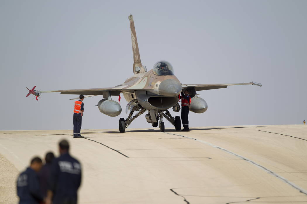Technicians inspect an Israeli air force F-16 jet at the Ovda airbase near Eilat, southern Israel, in 2013. (AP Photo/Ariel Schalit, File)