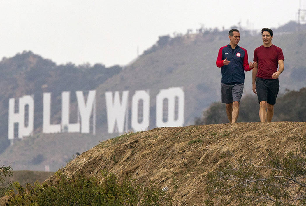 Los Angeles Mayor Eric Garcetti, left and Canadian Prime Minister Justin Trudeau take a hike in the Hollywood hills after a news conference at the Griffith Observatory, Saturday, Feb. 10, 2018 in  ...