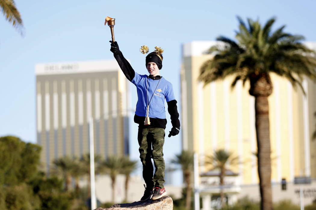 Nixon Herlean, 10, of Las Vegas participates in a torch relay, which was hosted by the Candlelighters Childhood Cancer Foundation of Nevada, in Las Vegas on Sunday, Feb. 11, 2018. The relay was cr ...