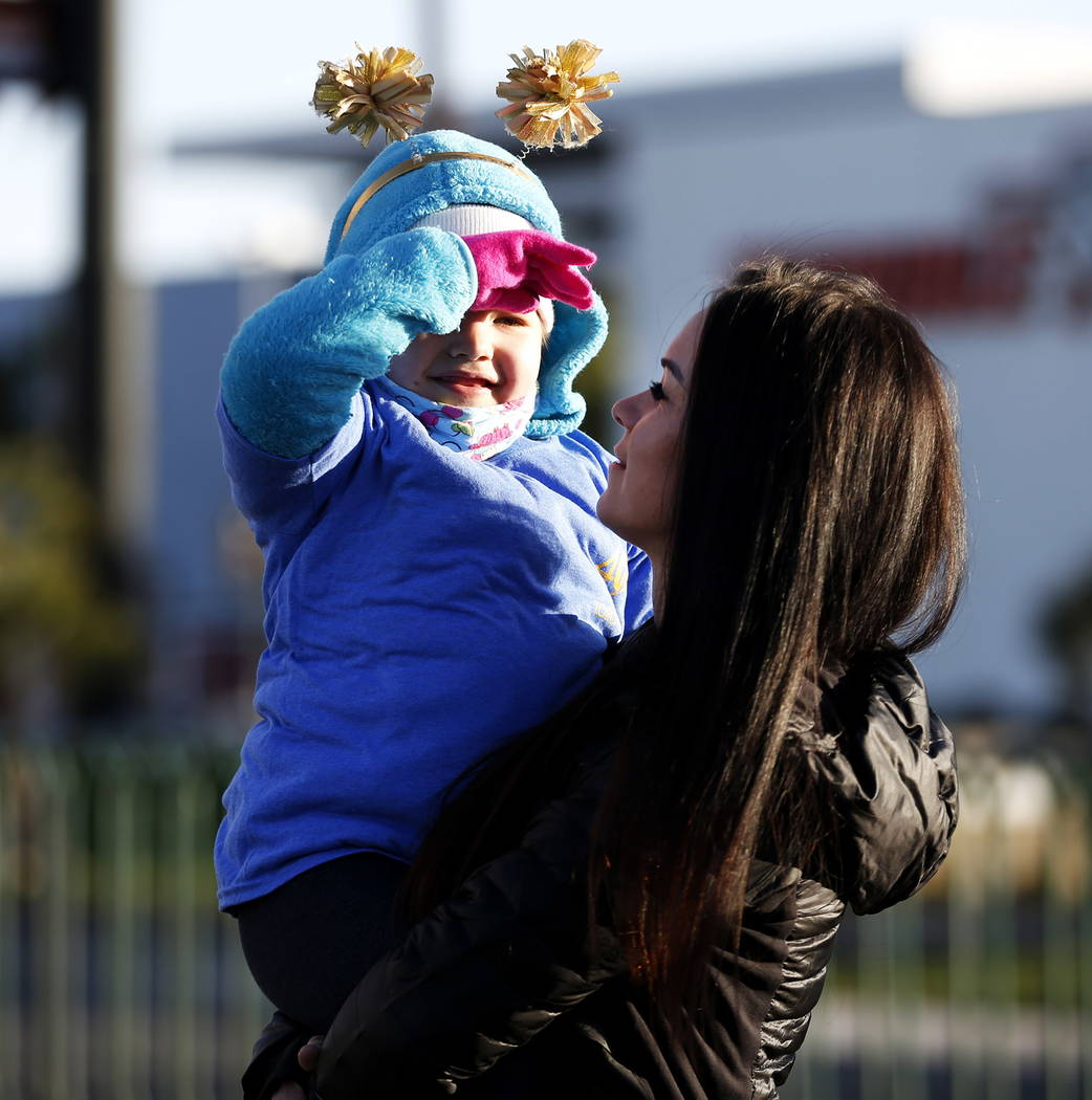 Brittany Herlean, 34, interacts with Mia Theriault, 6, before the torch relay, which was hosted by the Candlelighters Childhood Cancer Foundation of Nevada, in Las Vegas on Sunday, Feb. 11, 2018.  ...