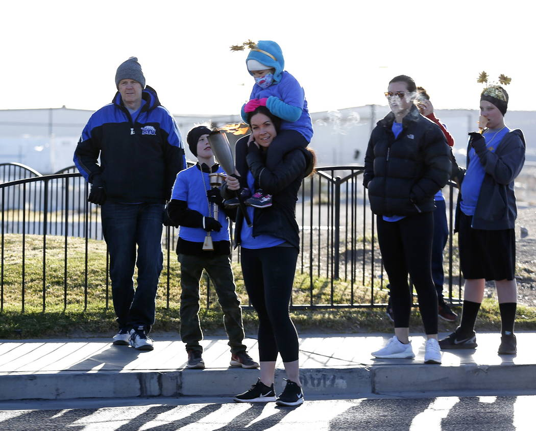 Participants attend a torch relay, which was hosted by the Candlelighters Childhood Cancer Foundation of Nevada, in Las Vegas on Sunday, Feb. 11, 2018. The relay was created to honor Candlelighter ...