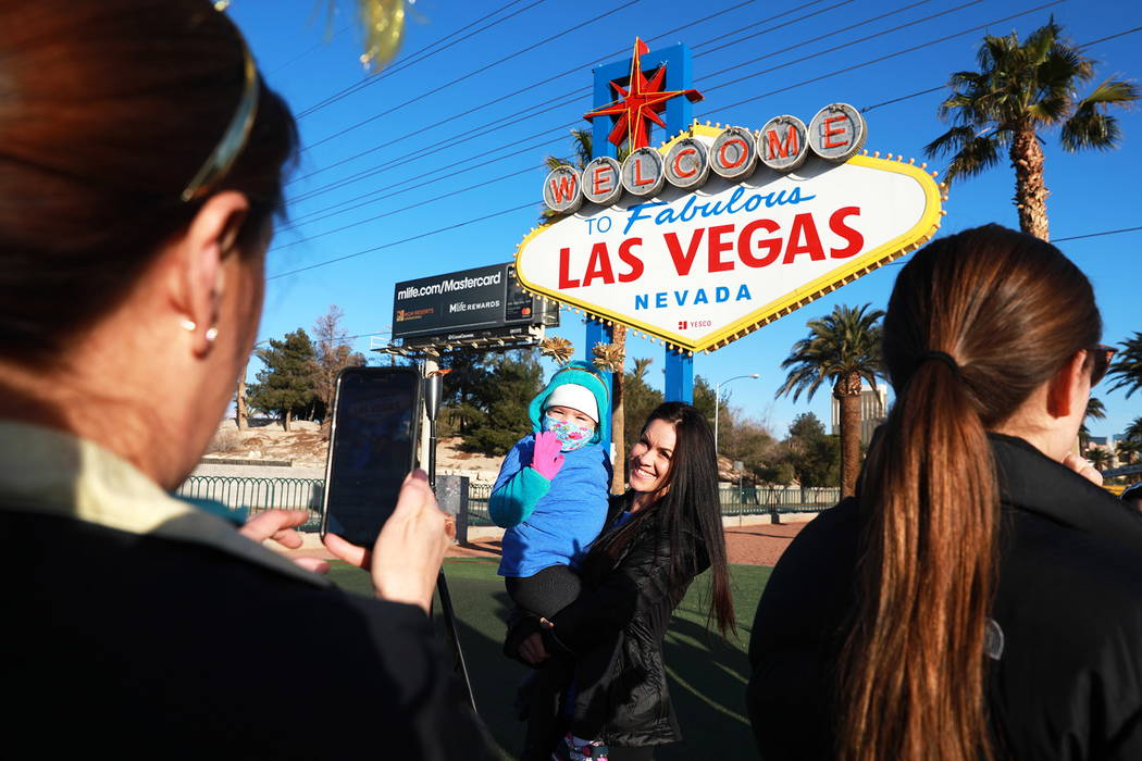 Brittany Herlean, 34, and Mia Theriault, 6, get their picture taken during the torch relay, which was hosted by the Candlelighters Childhood Cancer Foundation of Nevada, in Las Vegas on Sunday, Fe ...