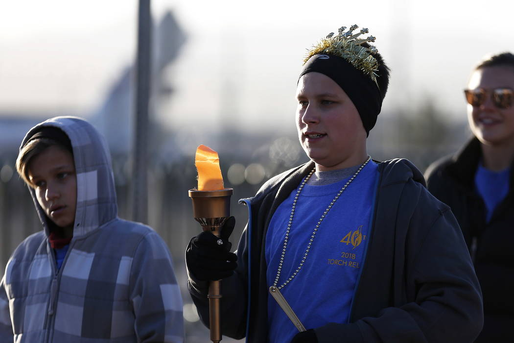 Krew Herlean, 14, participates in a torch relay, which was hosted by the Candlelighters Childhood Cancer Foundation of Nevada, in Las Vegas on Sunday, Feb. 11, 2018. The relay was created to honor ...