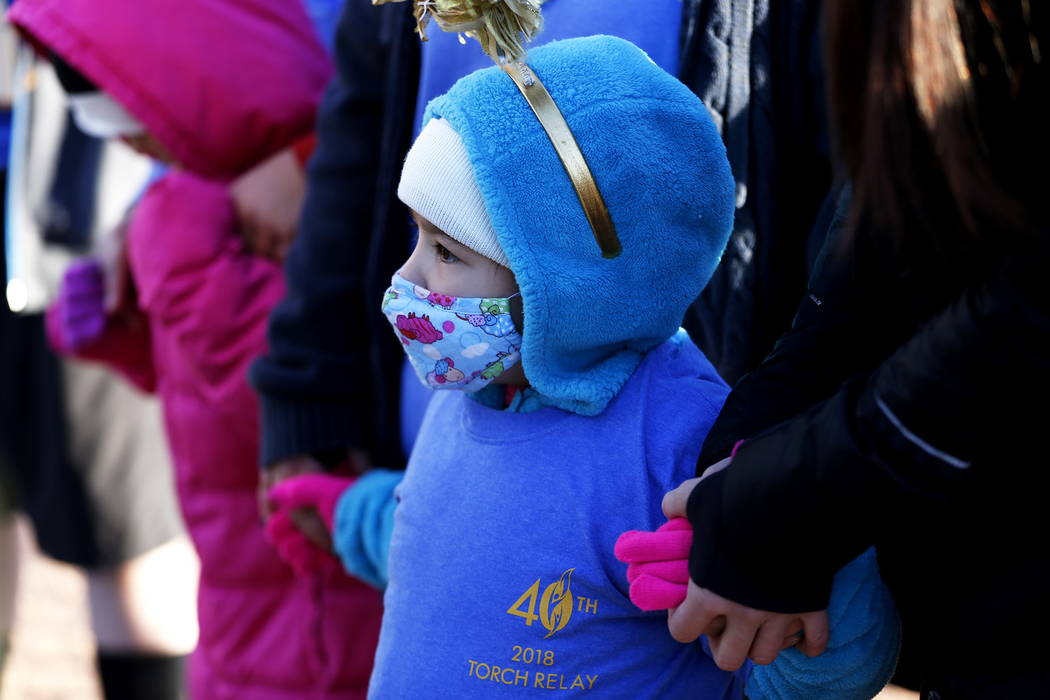 Mia Theriault, 6, attends a torch relay, which was hosted by the Candlelighters Childhood Cancer Foundation of Nevada, in Las Vegas on Sunday, Feb. 11, 2018. The relay was created to honor Candlel ...