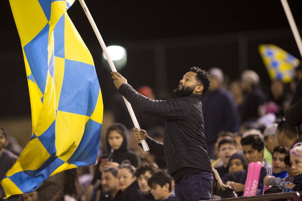 A fan waves a flag during the exhibition match between the Las Vegas Lights FC and Montreal Impact at Cashman Field in Las Vegas, Saturday, Feb. 10, 2018. Erik Verduzco Las Vegas Review-Journal @E ...