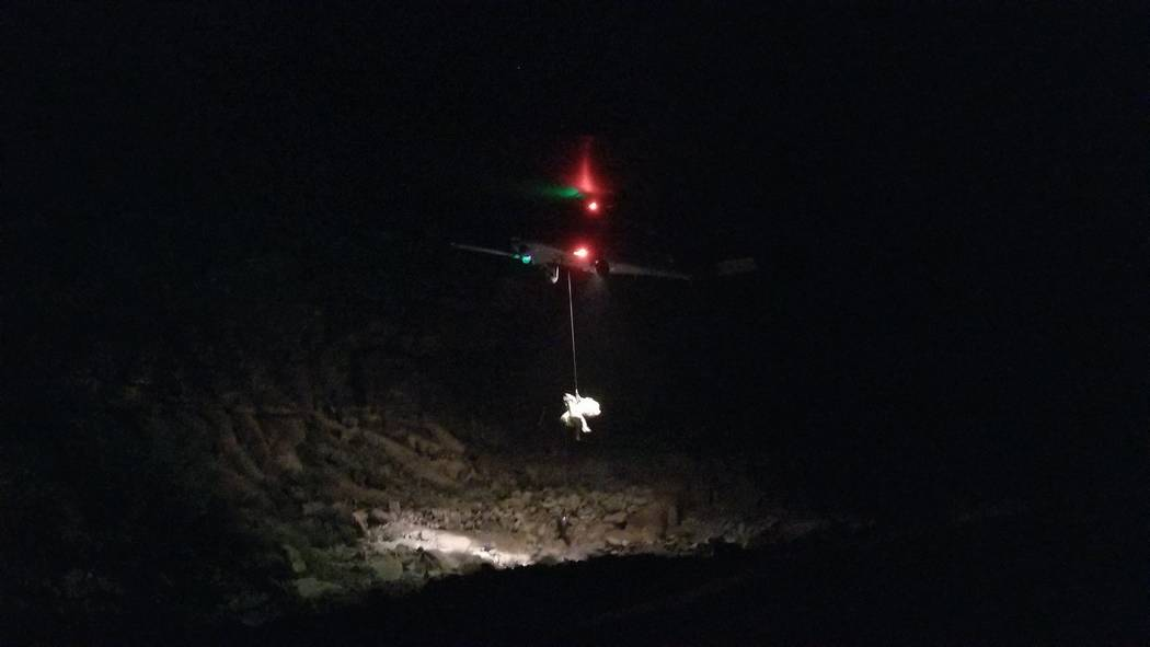 This photo shows the rescue efforts from the helicopter crash scene near Quartermaster Canyon, Ariz. A Papillon Grand Canyon helicopter crashed on Saturday, Feb. 10, 2018, and killed three people. ...
