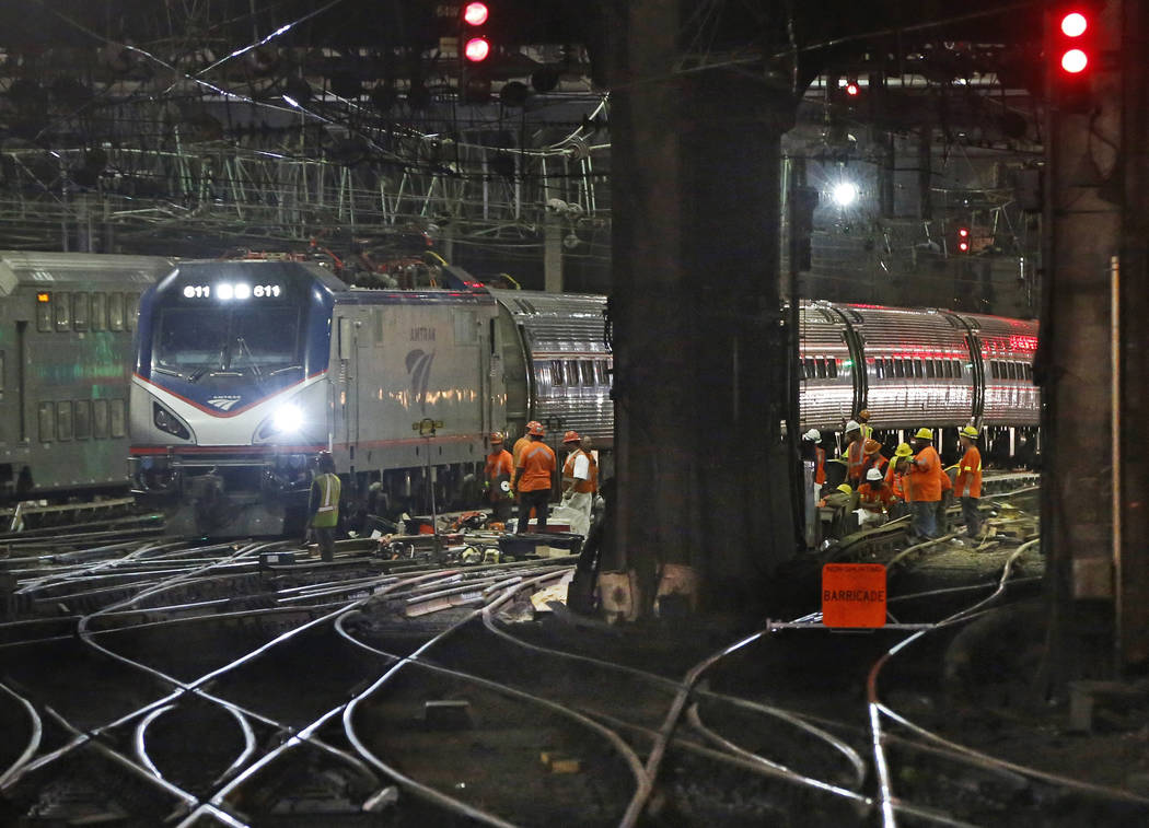 Amtrak workers continue ongoing infrastructure renewal work beneath Penn Station in New York, July 9, 2017. President Donald Trump on Monday, Feb. 12, 2018, will unveil his long-awaited infrastruc ...