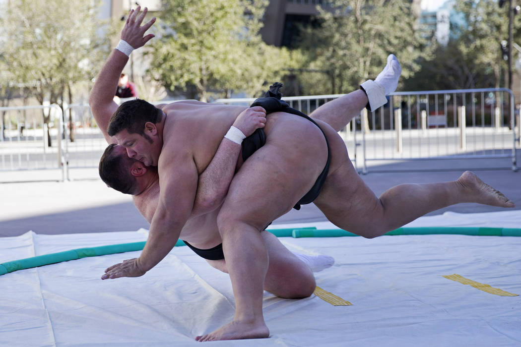 Professional sumo wrestlers Dan Kalbfleisch, right, drops Soslan Gagloev during an Ultimate Sumo League press conference at Toshiba Plaza in Las Vegas, Wednesday, Feb. 7, 2018. Erik Verduzco Las V ...