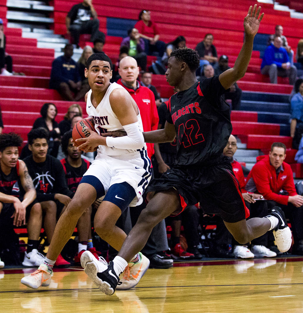 Liberty's Julian Strawther (0) tries to keep the ball away from Las Vegas' Miles Davis (42) at Liberty High School in Henderson on Tuesday, Feb. 13, 2018. Liberty won 82-70.  Patrick Connolly Las  ...