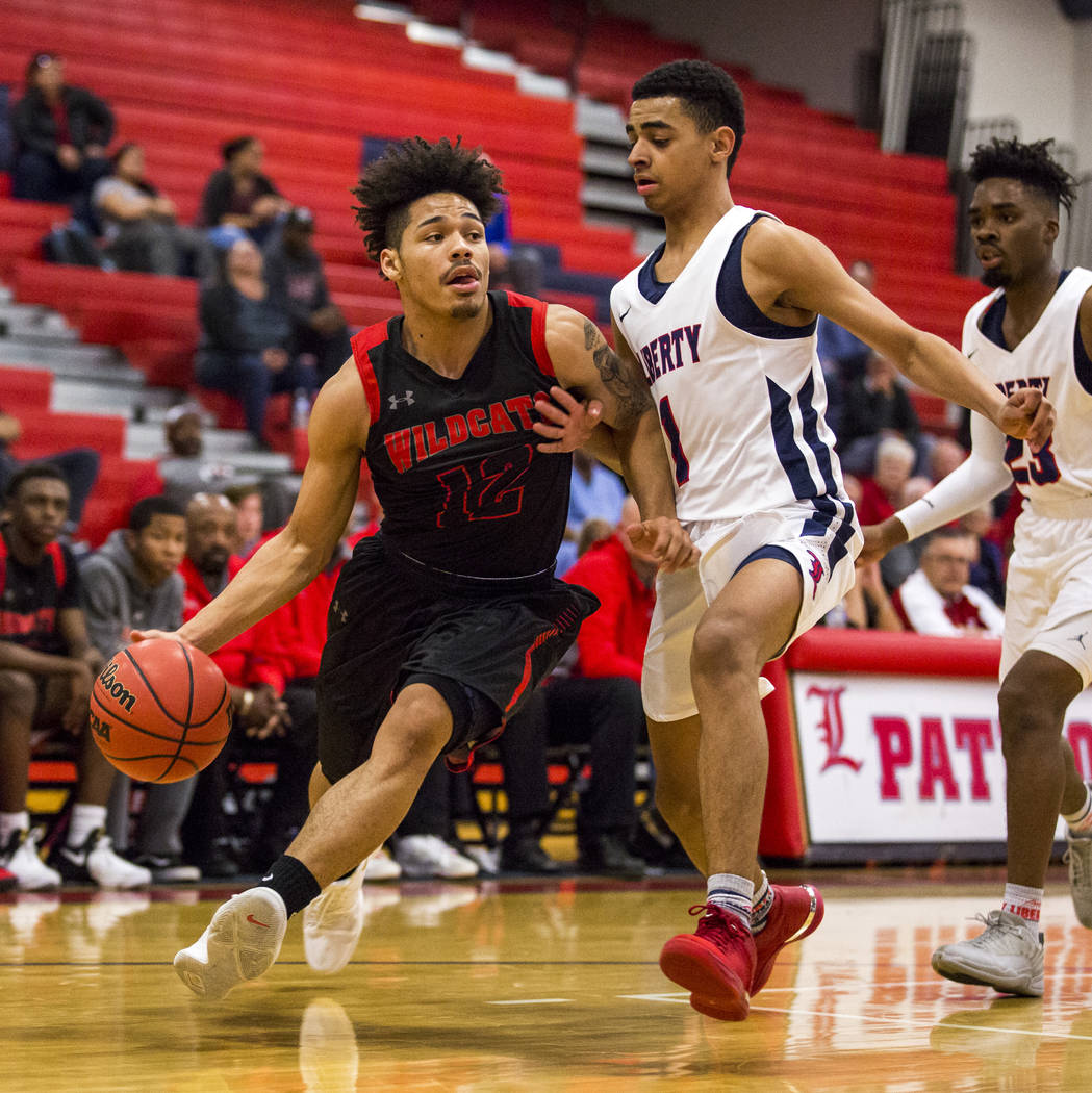 Las Vegas' Donovan Joyner (12) attempts to dribble around Liberty's Kobe Stroughter (1) at Liberty High School in Henderson on Tuesday, Feb. 13, 2018. Liberty won 82-70.  Patrick Connolly Las Vega ...