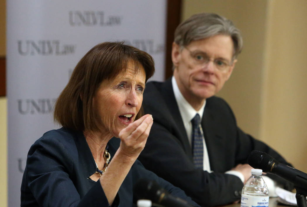 Dr. Leslie C. Griffin, left, professor of Law at the University of Nevada, speaks as Stephen Bates, an associate professor in the Hank Greenspun School of Journalism and Media Studies at the Unive ...