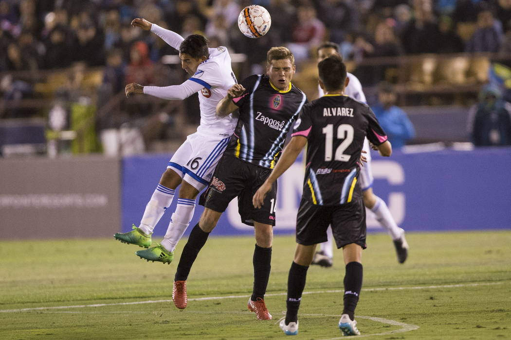 Montreal Impact's Jeisson Vargas (16) and Las Vegas Lights FC Marcelo Alex Mendoza (14) fight for the ball during the exhibition match at Cashman Field in Las Vegas, Saturday, Feb. 10, 2018 ...