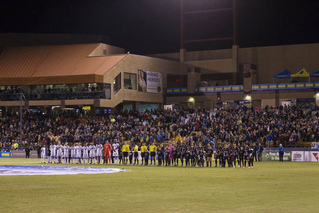 The Vancouver Whitecaps FC and Las Vegas Lights FC during the singing of the national anthem before their game at Cashman Field in Las Vegas, Saturday, Feb. 17, 2018. Erik Verduzco Las Vegas Revie ...